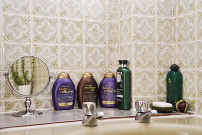 OGX shampoos and conditioners in matching colours, bath of Badedas, 1970s bathroom